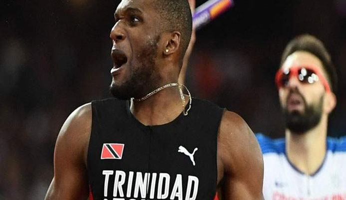 SAVOURING THE MOMENT: Trinidad and Tobago's Lalonde Gordon looks to the stands after completing victory in the men's 4x400m final at the IAAF World Championships in London on Saturday. —Photo: AFP
