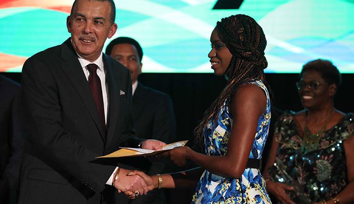 BONUS: Paralympian Nyoshia Cain, right, is presented with her medal bonus by President of the Republic His Excellency Anthony Carmona last Thursday at the TTOC Annual Awards held at the Hyatt Regency Hotel, Port of Spain.