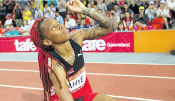 Michelle-Lee Ahye of Trinidad and Tobago reacts after winning the women's 100m final at Carrara Stadium during the Commonwealth Games on the Gold Coast yesterday. More reactions on Pages A5 & A29 PICTURE AP