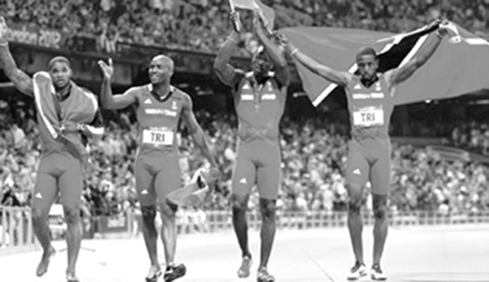 T&T's Keston Bledman, Emmanuel Callender, Marc Burns and Richard Thompson celebrate after winning the bronze medals for the men's 4x100 metres during the 2012 Summer Olympics, London. AP Photo