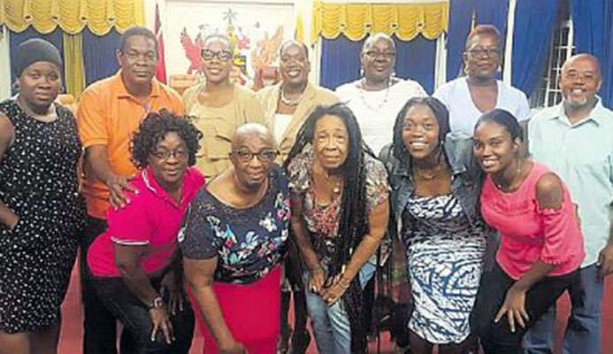 Former national netballer Peggy Castanada, third from left front row poses with other coaches and indiviudals, who will play a major part in the Regional Corporation's 'Back 2 Basics' Community Netball Programme, at a Meet and Greet reception on July 4 at the Arima Town Hall. With her are Nikeisha Felix-Lewis, from left, back row, Councillor Michael Castellano (Arima Borough Corporation), Alderman Onika Haynes (Vice-Chair Tunapuna Piarco Regional Corporation), Jaime Browne (Programme Director), Jacqueline Morris, Margaret Francis, Councillor Anthony Davis (Arima Borough Corporation) and in the front row from left: Odette John, Veronica Mc Donald-Nicoll, Kielle Connelly and Daniella Hall.