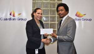 MEANINGFUL CONTRIBUTION: TTOC president Brian Lewis, right, receives a cheque from Guardian Group's senior manager – Group Corporate Communications, Ayesha Boucaud-Claxton, to aid the TTOC's #10golds24 Athlete Welfare and Preparation Fund at the company's headquarters at Columbus Circle, Westmoorings, last Friday.