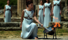 Katerina Lehou lights the Olympic flame in Ancient Olympia today ©Getty Images