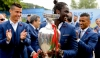 Éder displays the trophy to fans before leaving Portugal's base at Marcoussis on Monday morning. Photograph: Miguel A. Lopes/EPA