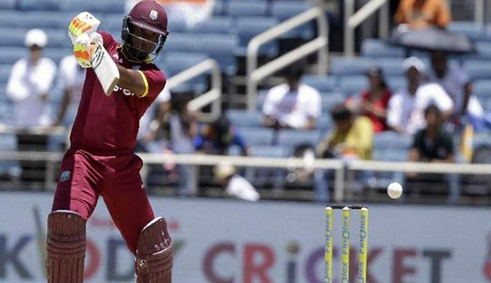 Bang!: West Indies opening batsman Evin Lewis smacks another delivery during his Man-of-the-Match 125 not out against India in their one-off T20 International at Sabina Park in Kingston, Jamaica, yesterday. West Indies won by nine wickets. —Photo: AP