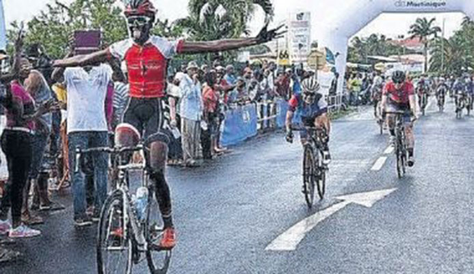 T&T cyclist Teneil Campell celebrates after crossing the finish line to win the Elite Women Caribbean Road Race on Saturday in Martinique. Yesterday Campbell successfully defender her title in the Individual Time Trial to become the first woman to ever achieve the Caribbean double.