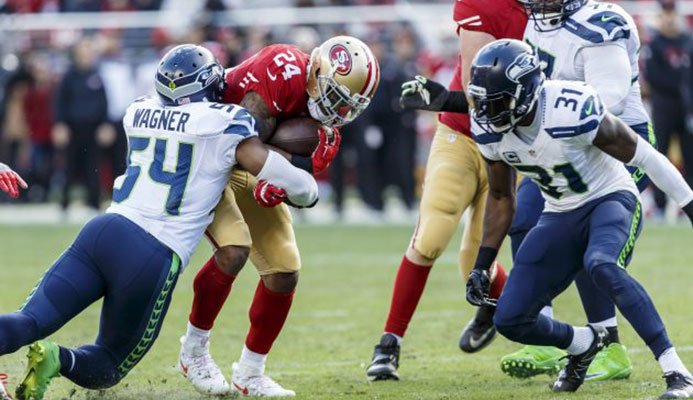 Hitting his man: Seattle Seahawks linebacker Bobby Wagner makes a play against San Francisco   Read more at https://www.rugbyworld.com/news/rugby-nfl-exchange-ideas-93441#FbK0Pb2ixuxKte1H.99