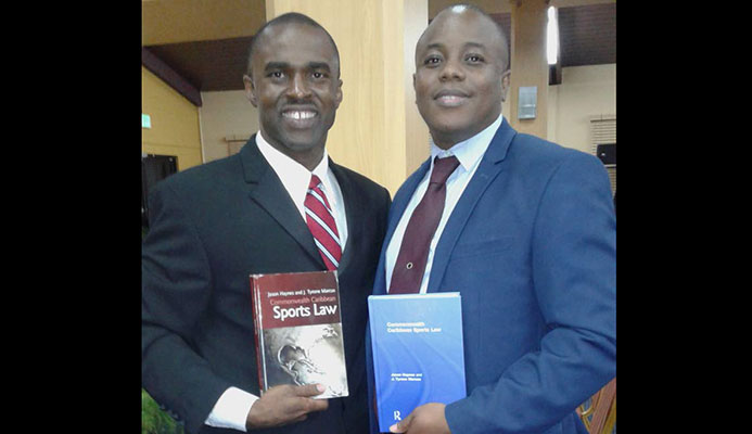 Tyrone Marcus (left) and Jason Haynes, after Tuesday's book launch at St Augustine.
