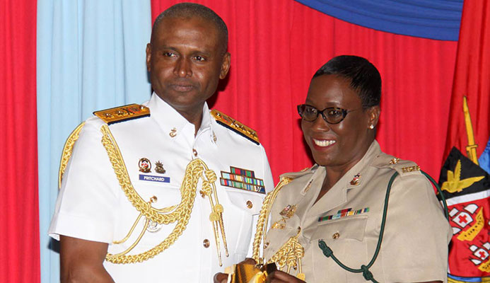 Chief of Defence Staff, Rear Admiral Hayden Pritchard, presents Major Leslie Ann McLeod-Mohammed, with an award for 30 years of Colour Service at the Launch of the Chief of Defence Staff's Military Women's Initiative, Hilton Hotel.