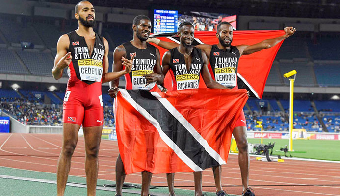GOLDEN QUARTET: (left to right) TT's Machel Cedenio, Asa Guevera, Jereem Richards and Deon Lendore celebrate after winning the 4x400 meters relay final at the IAAF World Relays on Sunday, in Yokohama, Japan. via AP