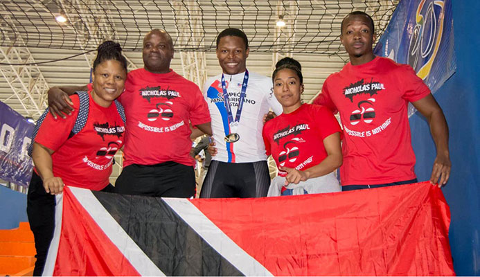 Family and friends of Nicholas Paul, centre, celebrate his gold medal performance in the Men's Sprint event at the Cochabamba Veldrome in Bolivia on Saturday night. (Photo courtesy Bolivia's Ministry of Sport)
