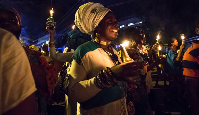 The flambeaux street procession is a hallmark of Emancipation celebrations. Photo by Maria Nunes