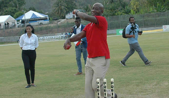 Prime Minister Dr Keith Rowley bowls the first ball during the opening of the Diego Martin Sporting Complex in Diego Martin, on Sunday.