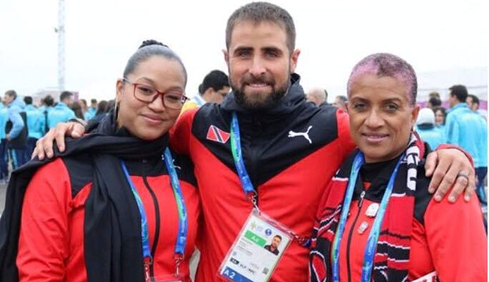Flag bearer national sailor Andrew Lewis, centre, with Chef de Mission Diane Henderson, right, and Deputy Chef de Mission Lovie Santana at Pan American Games in Lima, Peru.