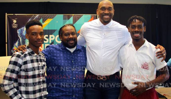Kibwe Trim (second from right), former professional basketballer and founder of DreamChaser International Foundation interacts with brothers Zion Nicholas, left, and Israel Nicholas, right, recipients of the Scholar Athlete of the Year Award 2020 from the DreamChaser International Foundation, alongside their father Kieno Nicholas at the annual TT Olympic Committee Sport Industry Conference 2020, held at the Hyatt Regency, Port of Spain, last Thursday. - ROGER JACOB