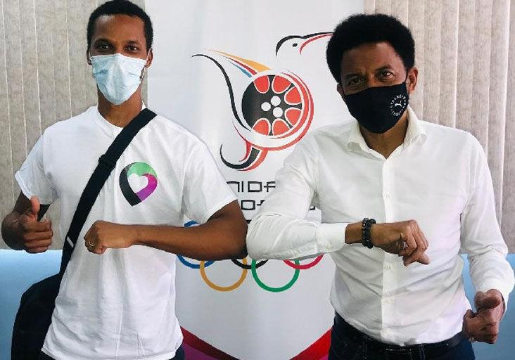 IN THE INTEREST OF SPORT: LUHU app co-founder Zwede Hewitt, left, and Trinidad and Tobago Olympic Committee (TTOC) president Brian Lewis celebrate the TTOC/LUHU partnership at the TTOC headquarters, Abercromby Street, Port of Spain, recently.